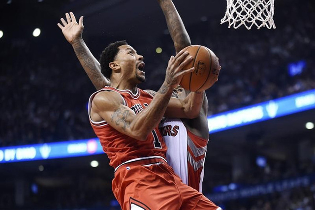 Nov 13, 2014; Toronto, Ontario, CAN;  Chicago Bulls guard Derrick Rose (1) jumps to score against the Toronto Raptors during the first quarter at Air Canada Centre. (Peter Llewellyn-USA TODAY Sports)