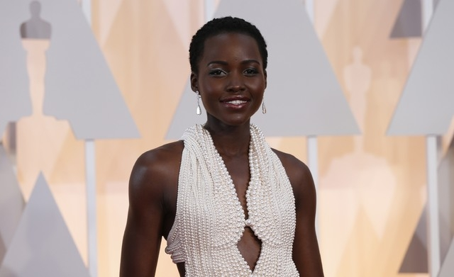 Actress Lupita Nyong'o wears a Calvin Klein gown and Chopard diamonds as she arrives at the 87th Academy Awards in Hollywood, California in this February 22, 2015 file photo. The $150,000 pearl-st ...