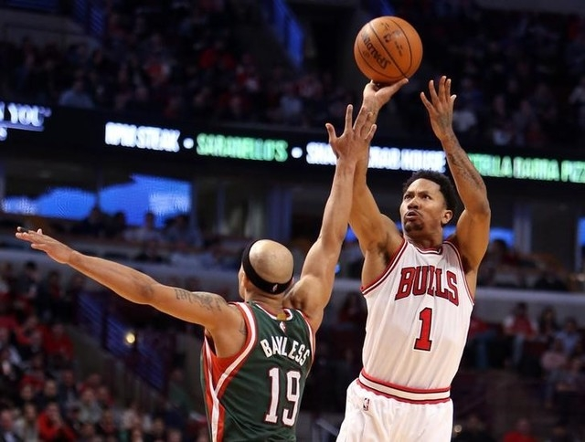 Feb 23, 2015; Chicago, IL, USA; Chicago Bulls guard Derrick Rose (1) makes a jump shot against Milwaukee Bucks guard Jerryd Bayless (19) in the second half during the game at United Center. (Caylo ...