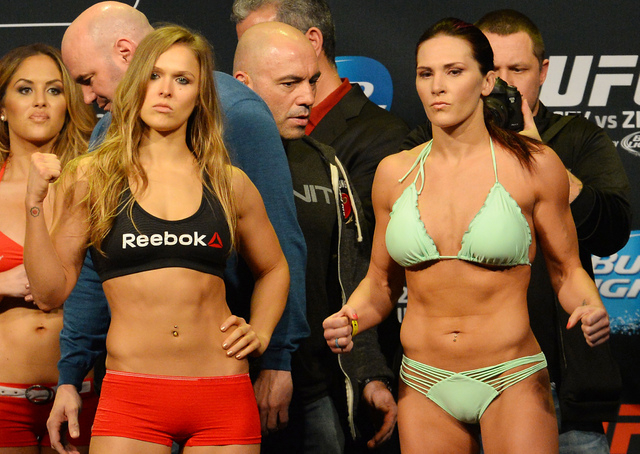 Feb 27, 2015; Los Angeles, CA, USA; Ronda Rousey and Cat Zingano face off at the weigh-in for their fight at UFC 184 at Staples Center. Mandatory Credit: Jayne Kamin-Oncea-USA TODAY Sports