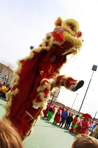 Lion dancers at a Beijing temple fair.