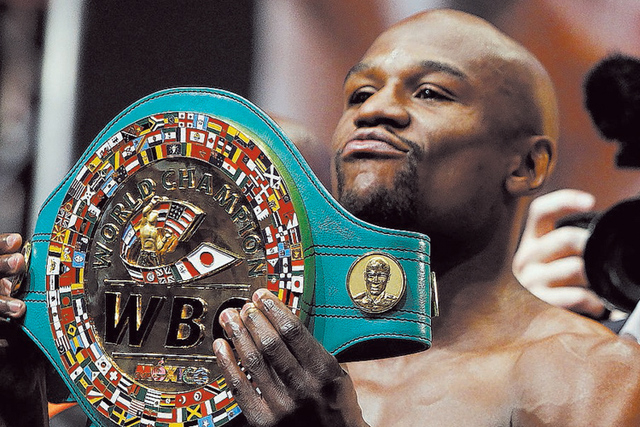 Floyd Mayweather displays his WBC Championship belt during a weigh-in for his fight against Canelo Alvarez at the MGM Grand in 2013. (John Locher/Las Vegas Review-Journal File)