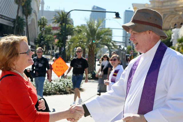 Pedestrian Susie Nelson-Crowley, left, stops to speak with the Rev. Barry Vaughn on the sidewalk along the Strip near The Mirage on Ash Wednesday (Ronda Churchill/Las Vegas Review-Journal)