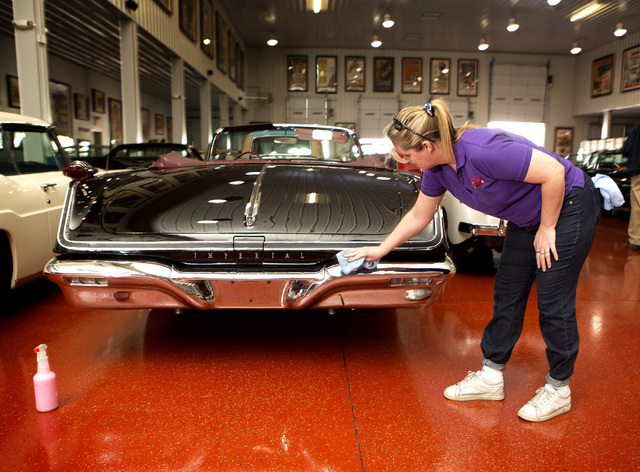 Karen Bovino details a 1958 Chrysler Imperial at the Rogers' Classic Car Museum, 1480 Gragson Avenue, on Tuesday, Feb. 3, 2015. (Jeff Scheid/Las Vegas Review-Journal)