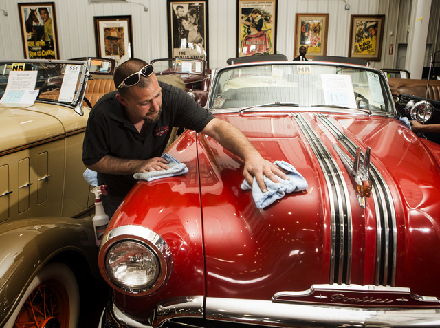 Corey Johnson details a 1953 Pontiac Chieftain DeLuxe Convertible at the Rogers' Classic Car Museum, 1480 Gragson Avenue, on Tuesday, Feb. 3, 2015.  (Jeff Scheid/Las Vegas Review-Journal)