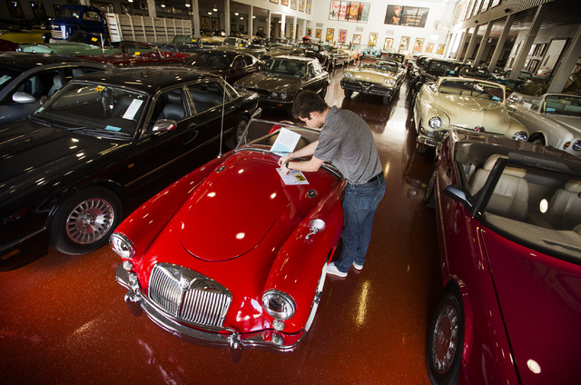 Joe Boyle with Mecum Auctions tags a 1956 MG A Roadster at the Rogers' Classic Car Museum, 1480 Gragson Avenue, on Tuesday, Feb. 3, 2015. (Jeff Scheid/Las Vegas Review-Journal)