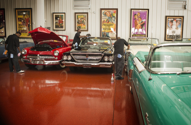 Workmen detail automobiles at the Rogers' Classic Car Museum, 1480 Gragson Avenue, on Tuesday, Feb. 3, 2015.  Nearly 250 cars  owned by the late businessman Jim Rogers will be auctioned off on Sat ...