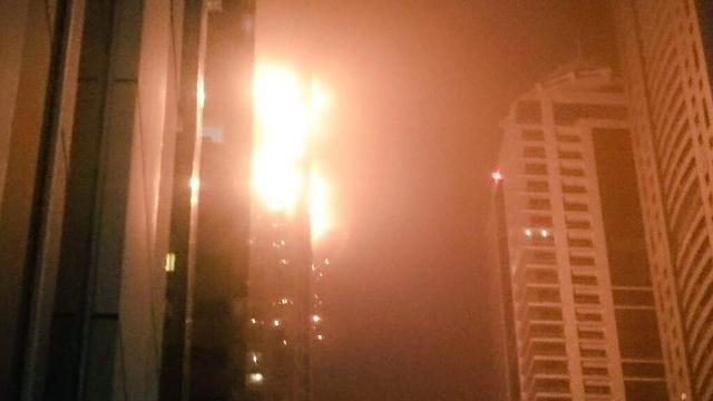 A fire spreads across 12 floors of the Marina Torch building in Dubai, UAE. (Manthan Unadkat/Fresco News)