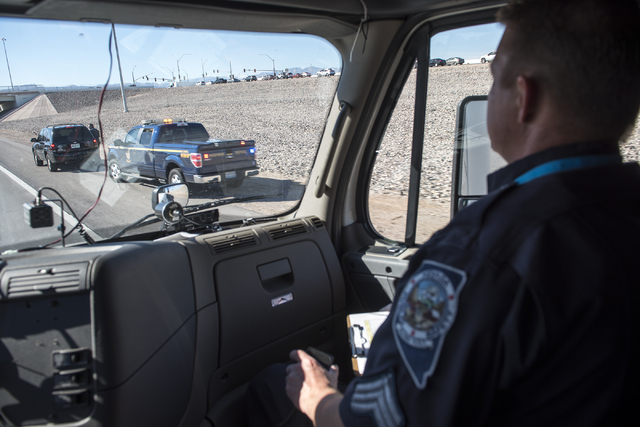 Sgt. Michael Cooke of the Nevada Highway Patrol spots one of the participating officers during a traffic stop in Las Vegas on Wednesday, Feb. 25, 2015. Highway Patrol troopers worked together as p ...