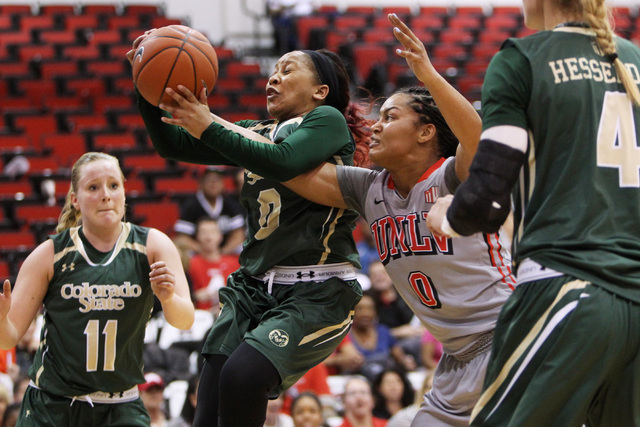 Colorado State guard A.J. Newton grabs a rebound from UNLV guard Amie Callaway during their Mountain West Conference Game Saturday, Feb. 7, 2015, at the Cox Pavilion. Colorado State won 55-43. (Sa ...