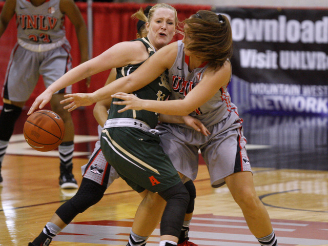UNLV forward Alana Cesarz fouls Colorado State guard Gritt Ryder during their Mountain West Conference Game Saturday, Feb. 7, 2015, at the Cox Pavilion. Colorado State won 55-43. (Sam Morris/Las V ...