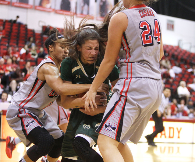 UNLV guard Nikki Wheatley and Colorado State guard Victoria Wells find themselves in a held ball situation during their Mountain West Conference Game Saturday, Feb. 7, 2015, at the Cox Pavilion. C ...
