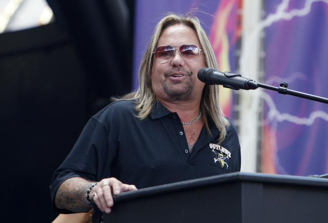 Team Owner Vince Neil speaks during an event to officially announce Las Vegas' new Arena Football League team, the Las Vegas Outlaws, Thursday, Sept. 25, 2014 at the Fremont Street Experience. (Sa ...