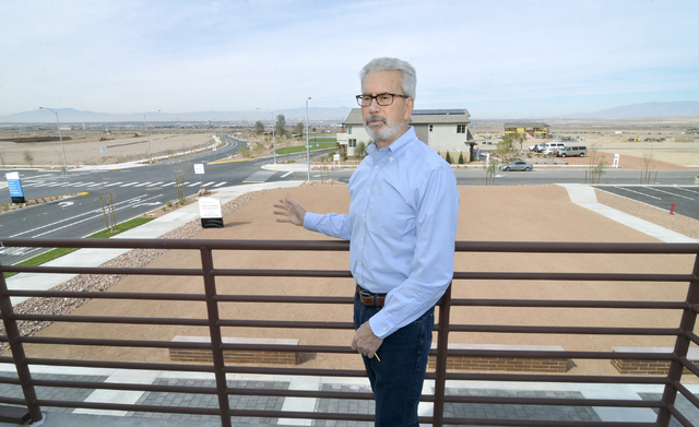 Mark Paris, president and CEO of Landwell Company, is shown on a balcony of the marketing center for Cadence, a 2,200-acre master planned community being developed by Landwell north of the interse ...