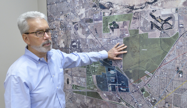Mark Paris, president and CEO of Landwell Company, is shown at the company offices at 875 W. Warm Springs Road on Friday, Feb. 21, 2015, with a map showing the location of Cadence, a 2,200-acre ma ...