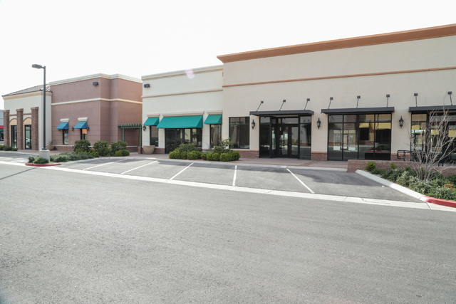 A view from the parking area shows several vacant storefronts at the site of Coral Academy of Science's proposed new campus at West Horizon Ridge Parkway and Green Valley Parkway, Henderson, Thurs ...