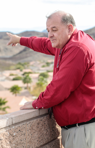 Sun City McDonald Ranch general manager Ron Winkel points to the homes that border the back parking area of the proposed Coral Academy of Science's new campus at West Horizon Ridge Parkway and Gre ...