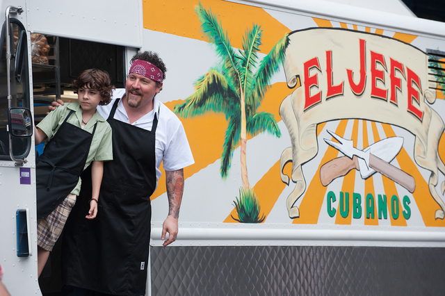 """Emjay Anthony, left, and writer-director Jon Favreau star in """"Chef."""" (Photo by Merrick Morton)"""