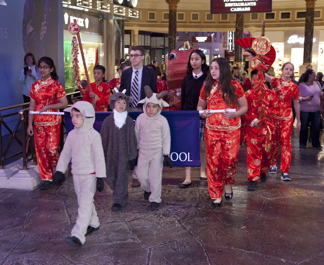 Kindergartners and fifth-graders from The Meadows School are seen Feb. 19 as they celebrate the first day of Chinese New Year and welcome the Year of the Goat/Sheep at The Forum Shops at Caesars.  ...
