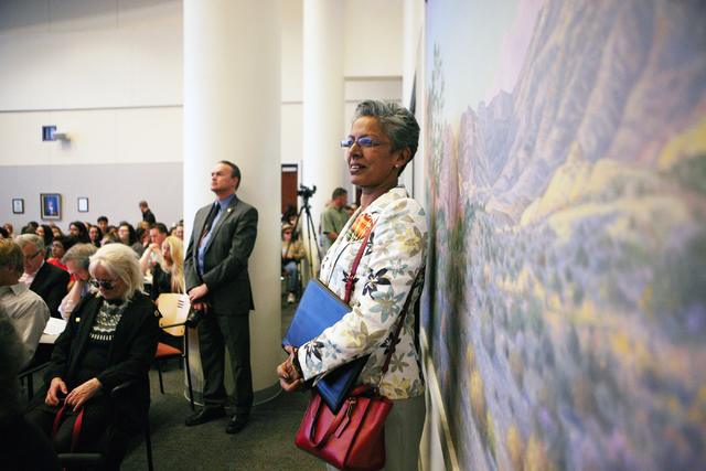 Punam Mathur, center, stands during a conversation about conservation issues in Southern Nevada at Lloyd D. George U.S. Courthouse, Wednesday, Feb. 18, 2015, in Las Vegas. (Ronda Churchill/Review- ...