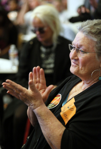 Terri Robertson claps during a conversation about conservation issues in Southern Nevada at Lloyd D. George U.S. Courthouse, Wednesday, Feb. 18, 2015, in Las Vegas. (Ronda Churchill/Review-Journal)