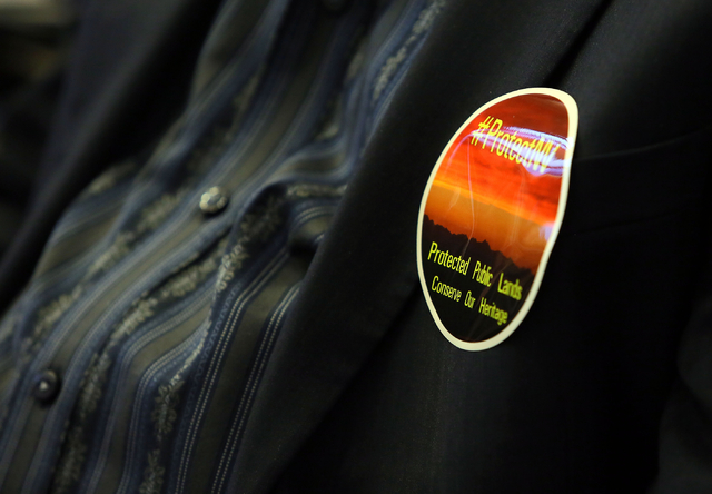 """A sticker with the phrase """"Protected Public Lands; Conserve Our Heritage"""" is worn on a jacket during a conversation about conservation issues in Southern Nevada at Lloyd D. George U.S. Courthouse, ..."""