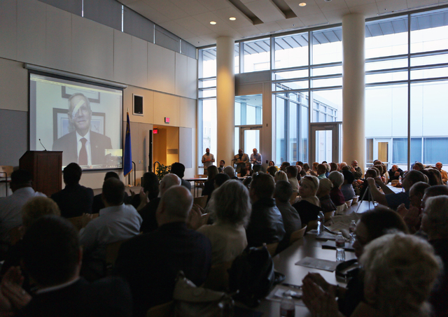 Sen. Harry Reid, D-Nev., speaks remotely during a conversation about conservation issues in Southern Nevada at Lloyd D. George U.S. Courthouse, Wednesday, Feb. 18, 2015, in Las Vegas.  (Ronda Chur ...
