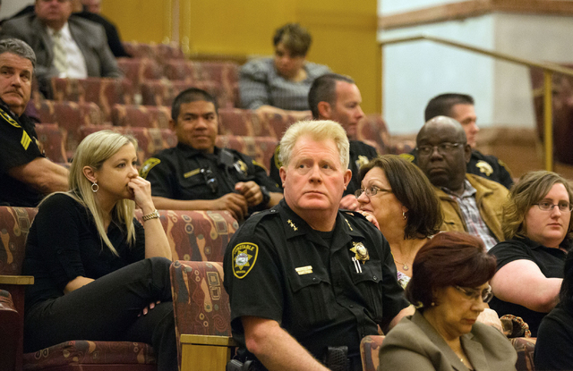 Deputy Chief of the Las Vegas Township Constable's office, Dean Lauer, center, and others react to the Clark County Commissioners' unanimous decision to abolish the constable's office Tuesday, Mar ...