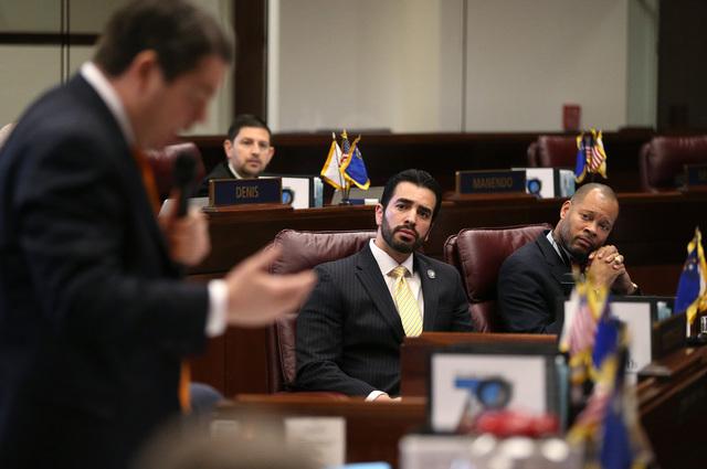 Nevada Senate Democrats Ruben Kihuen, center, and Aaron Ford, right, listen as Senate Majority Leader Michael Roberson, R-Henderson, speaks during a lengthy Senate floor debate at the Legislative  ...