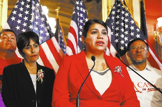 Immigration activist Astrid Silva (in red) stands next to her mother, Barbara Silva, as she speaks about immigration reform at a news conference on Capitol Hill in Washington December 10, 2014.    ...