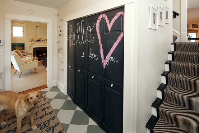 Tribune News Service Chalkboard paint covers the closet door in the entry of this home.