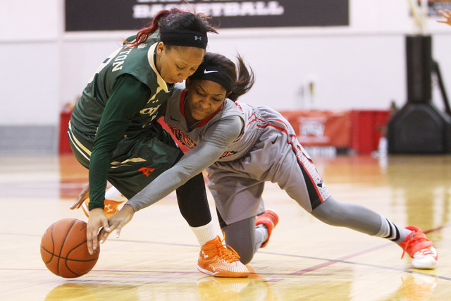 UNLV guard Danielle Miller, right, and Colorado State guard A.J. Newton fight for a loose ball during their Mountain West Conference Game Saturday, Feb. 7, 2015, at Cox Pavilion. Colorado State wo ...