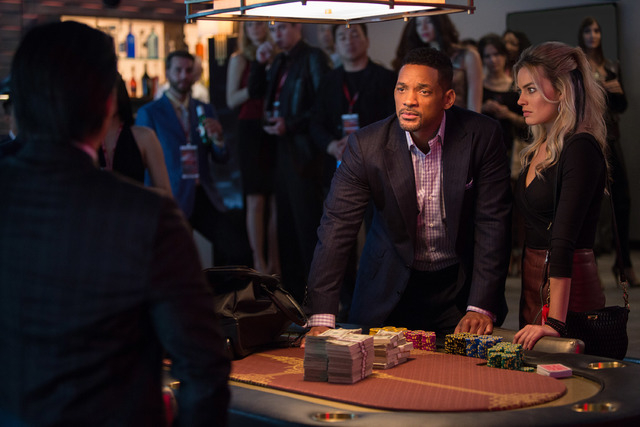 """Will Smith stars as Nicky and Margot Robbie as Jess in Warner Bros. Pictures' heist film """"Focus.""""  (Frank Masi/Warner Bros. Pictures)"""