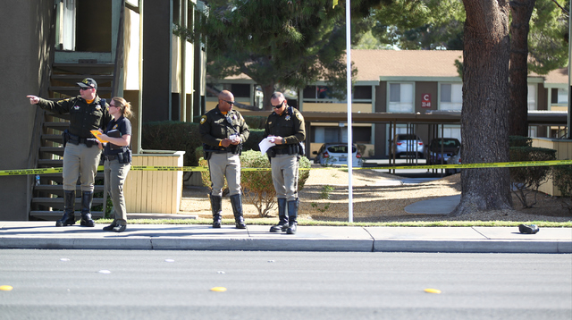 A lone shoe, on right, is seen on the sidewalk as Las Vegas police investigate the scene where a pedestrian was struck by a vehicle on Eastern near Karen avenues, in Las Vegas on Monday, Feb. 16,  ...