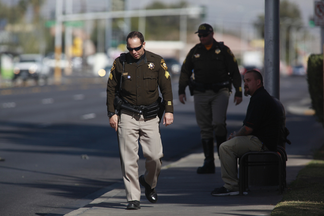 Las Vegas police investigate the scene where a pedestrian was struck by a vehicle on Eastern near Karen avenues, in Las Vegas on Monday, Feb. 16, 2015. The pedestrian is currently in critical cond ...