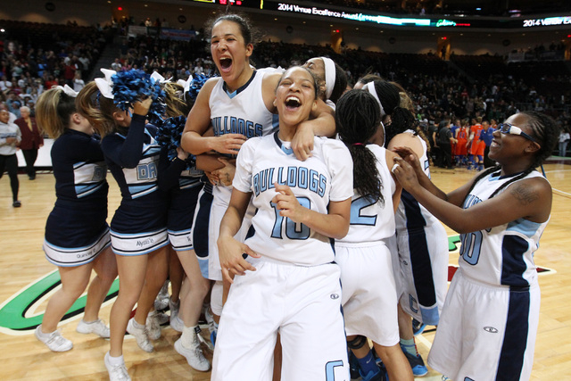 The Centennial girls basketball team celebrates its 65-52 win over Bishop Gorman in the Division I state championship game Friday, Feb. 27, 2015, at the Orleans Arena. (Sam Morris/Las Vegas Review ...