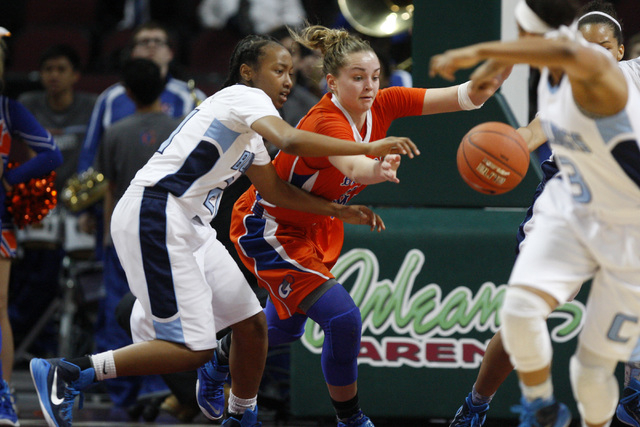 Centennial guard Justice Ethridge and Bishop Gorman guard Megan Jacobs chase a loose ball during their Division I state championship game Friday, Feb. 27, 2015, at the Orleans Arena. (Sam Morris/L ...