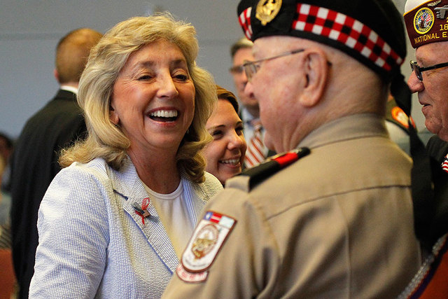 Rep. Dina Titus, D-Nev., talks with veterans before the Memorial Day ceremony at the Southern Nevada Veterans Memorial Cemetery in Boulder City on May 26, 2014. Titus and two other congressmen hav ...