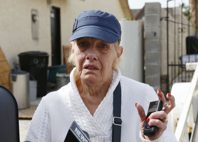 Janice Sisterman's husband was attacked by dogs when he tried to help a neighbor being attacked by four dogs in the 900 block of Looking Glass Lane, near Bonanza Road and Sloan Lane, on Friday, Fe ...