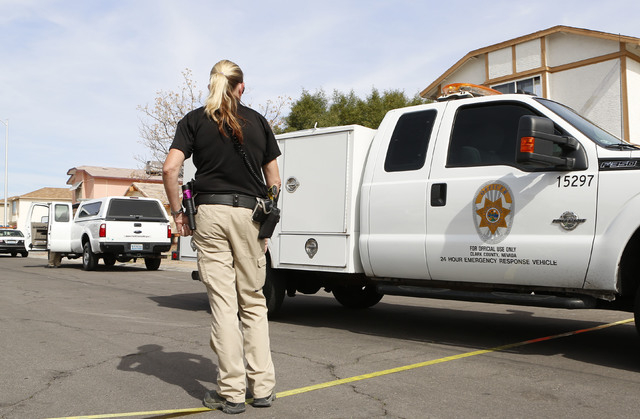 A Clark County animal control van leaves the scene where two people were attacked by dogs in the 900 block of Looking Glass Lane, near Bonanza Road and Sloan Lane, on Friday, Feb. 20, 2015. Two pe ...