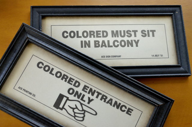 A pair of signs are shown on Friday, Feb. 6, 2015 in the office of Dr. Robert Green, who served as Dr. Martin Luther King Jr.'s director of education. He keeps the signs to remind him of where he  ...