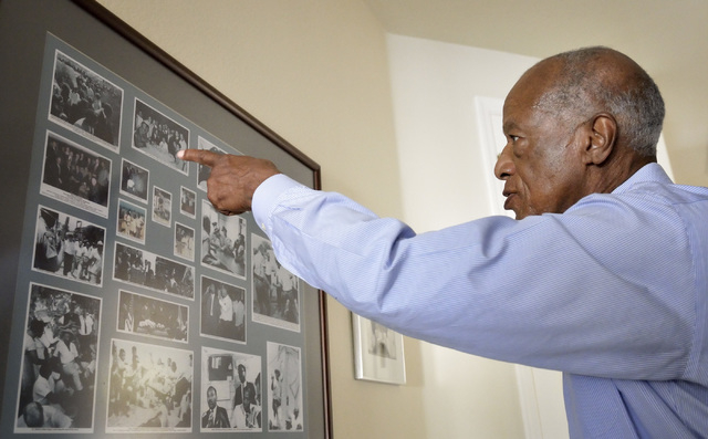 Dr. Robert Green, who served as Dr. Martin Luther King Jr.'s director of education, is shown at his home near Lake Mead and Sun City boulevards in Las Vegas on Friday, Feb. 6, 2015, with photos ta ...