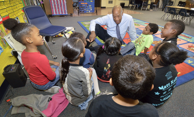 Dr. Robert Green, who served as Dr. Martin Luther King Jr.'s director of education, talks with students in teacher Ashley Wright's kindergarten class during a visit to Matt Kelly Elementary School ...