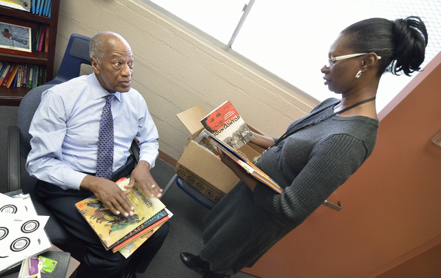 Dr. Robert Green, who served as Dr. Martin Luther King Jr.'s director of education, left, talks with assistant principal Loretta Lee while donating some books during a visit to Matt Kelly Elementa ...