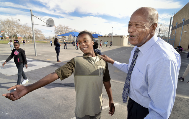 Dr. Robert Green, who served as Dr. Martin Luther King Jr.'s director of education, right, talks with fifth-grader Trayshaun Laushaul during a visit to Matt Kelly Elementary School at 900 J St. in ...