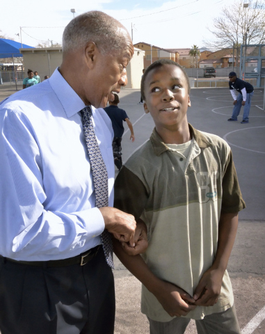Dr. Robert Green, who served as Dr. Martin Luther King Jr.'s director of education, left, talks with fifth-grader Trayshaun Laushaul during a visit to Matt Kelly Elementary School at 900 J St. in  ...