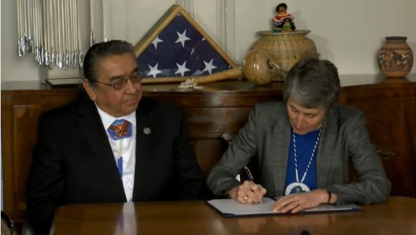 Interior Secretary Sally Jewell and Lindsey Manning, chairman of the Shoshone-Paiute Tribes of the Duck Valley Reservation, sign a water rights agreement Feb. 27, 2015 at the Department of Interio ...