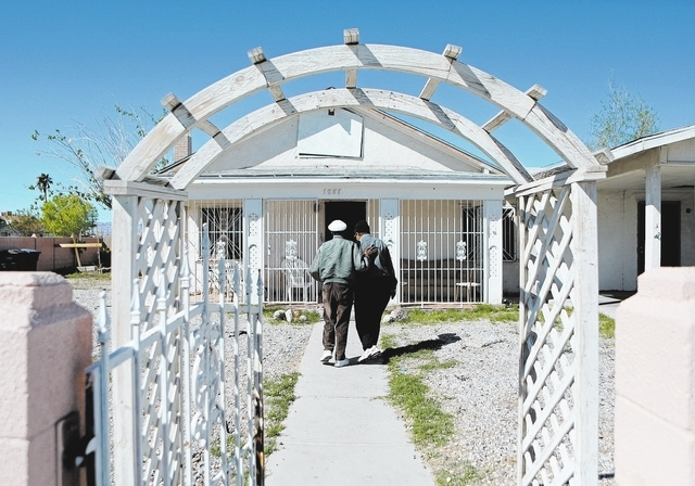 Arby Hambric, left, puts his hand on the shoulder of Lord Byron Gates Bartlett (both cq) while walking toward the Harrison House Wednesday, March 12, 2014, in Las Vegas. The Harrison House, which  ...