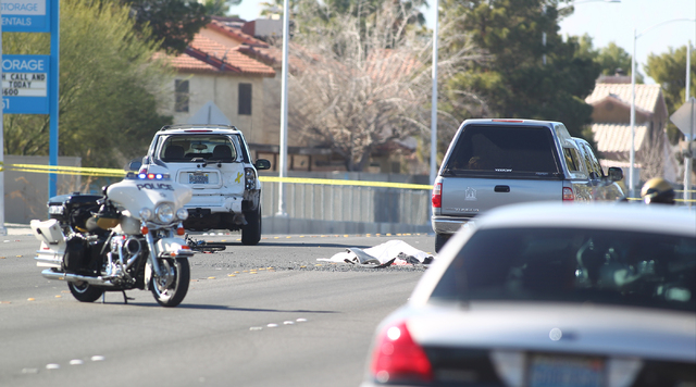 Las Vegas police investigate the scene involving a bicyclist who was killed in a crash with two vehicles on Bonanza Road near Nellis Boulevard in Las Vegas on Monday, Feb. 2, 2015. (Chase Stevens/ ...
