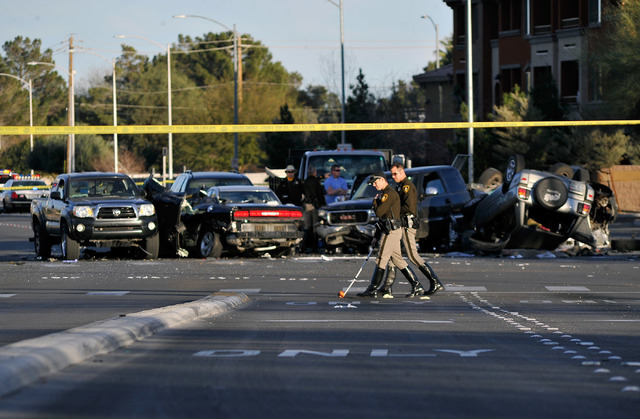 Las Vegas police investigate the site of a multi vehicle accident at along Cheyenne Avenue at Jones Boulevard  on Friday, Feb. 6, 2015. Roads were closed in each direction after the afternoon cras ...